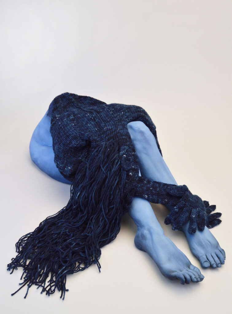 Sara Torgison blue lying figure sculpture